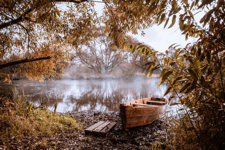 morning fog on the river and a forgotten boat on the banks of a mysterious river, beautiful landscape