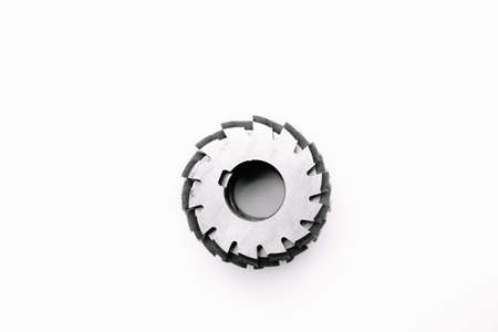 Metal disc milling cutter for industrial equipment. Tool isolated on a white background. Close-up. Фото со стока