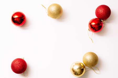 Christmas tree toys isolated on a white background. New year glitter balls red and gold color. Festive banner with place for text in fashion style. Close-up.