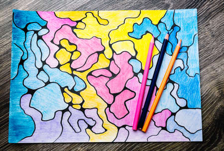 Abstract imaginary colorful picture of curves by colored pencils. A psychological art therapy tests. Identification of the unconscious, subconscious, the depths of the human brain. Drawing result.