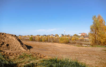 Land reclamation for property development. Sale of land at auction. Commercial building. Leveling, adding soil to the site. Land cleaning work. The first stage of lawn planting. Building area. Banner.