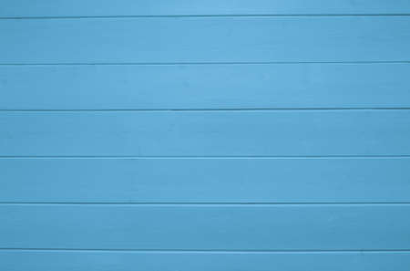 Blue wooden texture background. Copy space, text place. Backdrop. Wood finish material shop. Color banner. Steelblue painted plank timber. Wall lining. Rustic mockup. Indoor interior. Horizontal lines