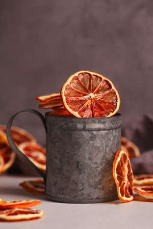 Dried fruit. Without sugar. Paste Homemade sweets. Dried fruits. Healthy fruit snack. Tangerines in a vintage tin Cup on a dark background