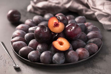 Delicious summer fresh plum on the plate