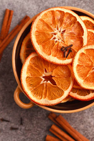 Dried fruit. Without sugar. Paste Homemade sweets. Dried fruits. Healthy fruit snack.Oranges in bowl with spices -loves, cinnamon and cardamom