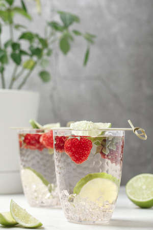 Strawberry mojito. Refreshing summer drink with berries, lime and mint.