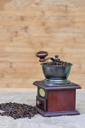 Coffee grinder full of roasted coffee beans and coffee beads