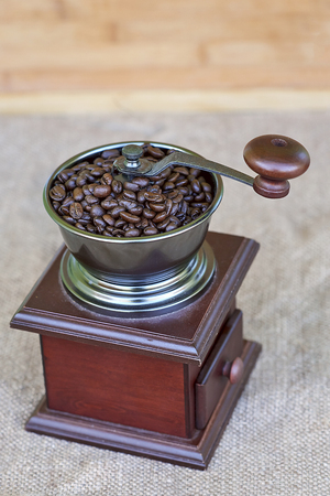 Coffee grinder full of roasted coffee beans - from the top Stock Photo