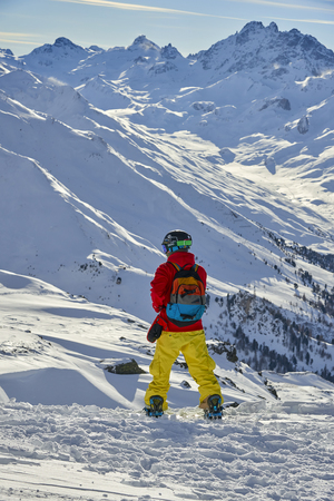 Ischgl, Austria - December 31, 2017: Snowboarder enjoying the nature in the mountains