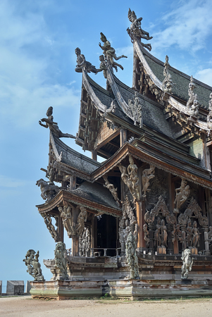 Pattaya, Thailand - February 22, 2011: Sanctuary of Truth is a religious construction in Pattaya, Thailand. The sanctuary is an all-wood building filled with sculptures based on the traditional Buddhist and Hindu motifs. The top of the building is 105 met Editorial