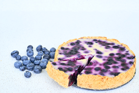 Blueberry pie and blueberries on a white background - close up