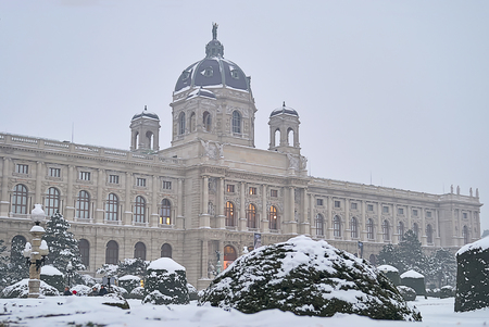 Vienna, Austria - 20 January, 2013: Natural History Museum in Vienna in foggy morning after snowfall. Everything aroun is covered with snow after strong snowfall.