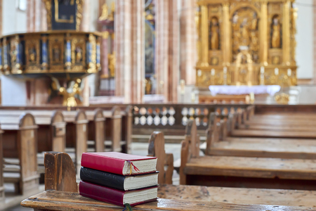The Bible lies on a wooden bench inside the Church
