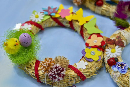 Easter wreath with Easter eggs, baby chicken and easter decorations