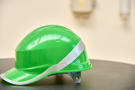 Green safety helmet on a table