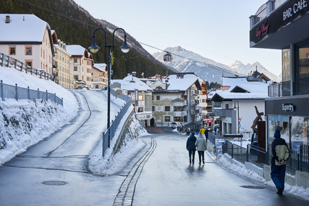 Ischgl, Austria - December 24, 2017: Modern aerial tramway in the Austrian Alps ski resort. Highway cable car slopes. Cable car station locates in Ischgl city center