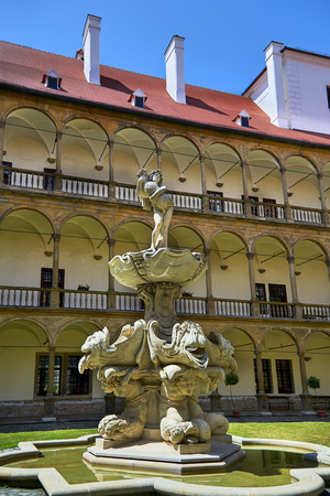 Buchovice, Czech Republic - June 10, 2018: Renaissance chateau Buchovice was built it 1575-1585. Unique central courtyard has 96 columns with rich decoration. Beautiful mannerist fountain on the courtyard was built in 1635-37.