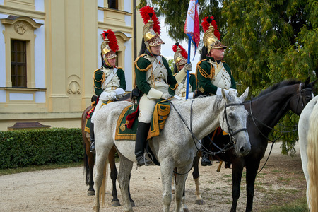 Slavkov u Brna, Czech Republic - August 11, 2018: Slavkov-Austerlitz castle historical reenactment. Procession of horsemen in the historical from Napoleon Bonaparte in the great court of the Slavkov-Austerlitz castle. Standard-Bild - 114642760