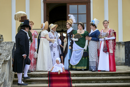 Slavkov u Brna, Czech Republic - August 11, 2018: Slavkov-Austerlitz castle historical reenactment. Ladies and gentlemen in the historical costumes of Napoleon Bonaparte in Slavkov-Austerlitz castle porch