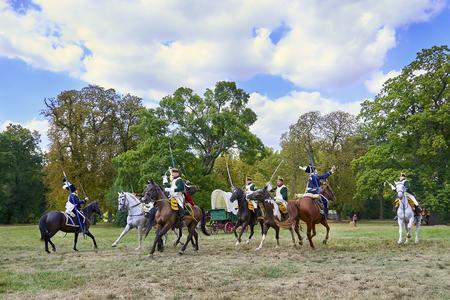 Slavkov u Brna, Czech Republic - August 11, 2018: Historical reenactment of Battle of the Three Emperors in Slavkov-Austerlitz, cavalery goes on the attack Standard-Bild - 114642755