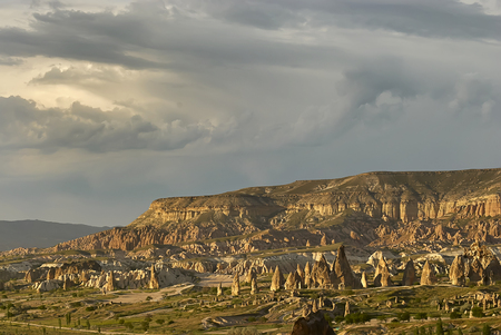 Colorful Rose Valley in Cappadocia landscape with dramatic sky Standard-Bild - 114618536