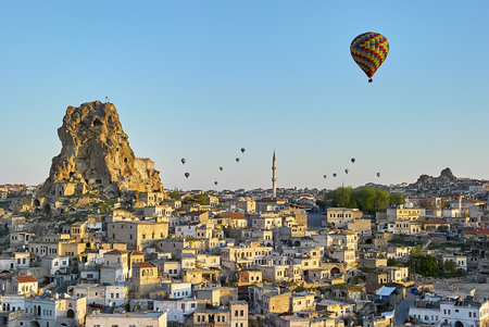 Cappadocia, Turkey: Colorful hot air balloons flying over the valley at Cappadocia. Hot air balloons are traditional touristic attraction in Cappadocia. Standard-Bild - 114618718