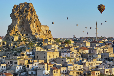 Cappadocia, Turkey: Colorful hot air balloons flying over the valley at Cappadocia. Hot air balloons are traditional touristic attraction in Cappadocia.