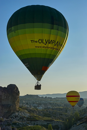 Cappadocia, Turkey - April 29, 2013 ? Colorful hot air balloons flying over the valley at Cappadocia. Hot air balloons are traditional touristic attraction in Cappadocia. Banque d'images - 114642776