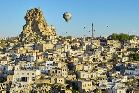 Cappadocia, Turkey: Colorful hot air balloons flying over the valley at Cappadocia. Hot air balloons are traditional touristic attraction in Cappadocia. Standard-Bild - 114618795