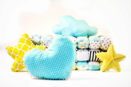 Pillows and patchwork comforter on white background Imagens