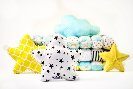 Pillows and patchwork comforter on white background Standard-Bild - 114618503