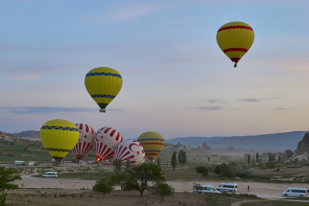 Cappadocia, Turkey - May 02, 2013 ? Colorful hot air balloons flying over the valley at Cappadocia. Hot air balloons are traditional touristic attraction in Cappadocia. Banque d'images - 122970799