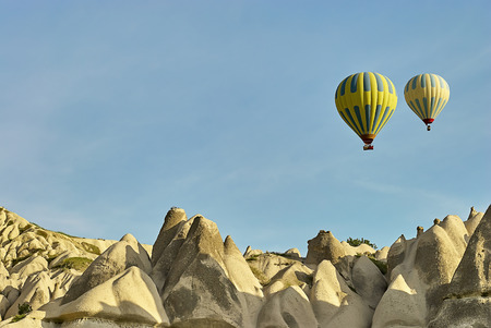 Cappadocia, Turkey - May 02, 2013: Colorful hot air balloons flying over the valley at Cappadocia. Hot air balloons are traditional touristic attraction in Cappadocia. Banque d'images - 122970811