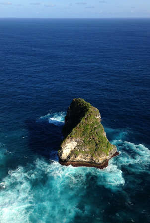 Rock in the ocean on Nusa Penida island, Indonesia. Stock Photo