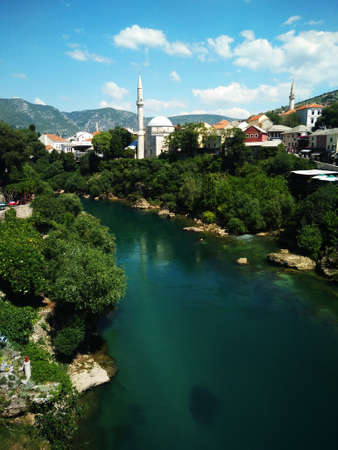 Reconstructed old Bridge in Mostar with emerald river Neretva. Bosnia and Herzegovina.