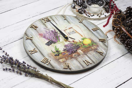 provance clock and dry lavander on wooden white bacrground. Light rustic table Archivio Fotografico