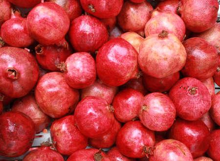 Group of pomegranates. Pomegranate closeup, background. Red fruits for eco, frash juice. Stock Photo