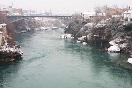 Mostar bridge in Bosnia and Herzegovina in winter. The Neretva river.