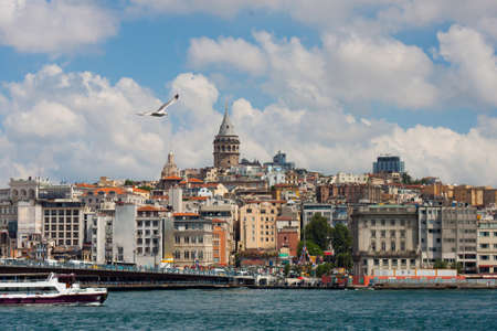 Istambul city view from a ferry or boat. Seascape with blue sea and cloudy sky. Standard-Bild
