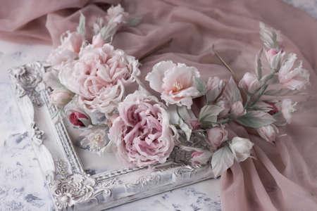 Pink silk flower wedding wreath on white background. Handmade hair flower crown.