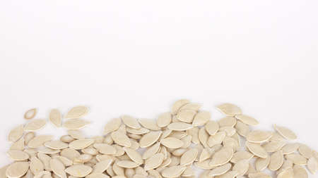 raw superfoods pumpkin seeds on white background Stock fotó