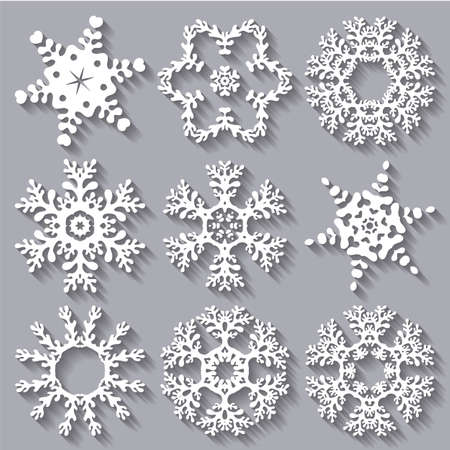 Snowflakes flat icon set collection. Set of nine carved varied snowflakes with long shadows. Ilustração