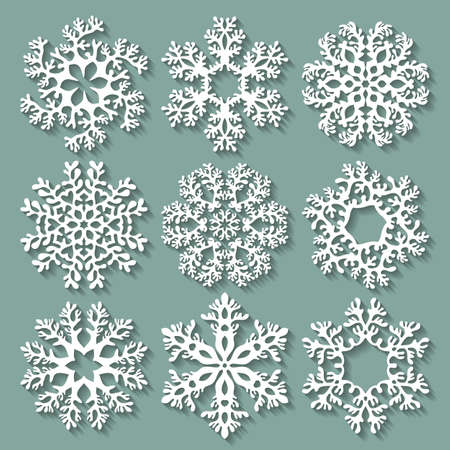varied: Snowflakes flat icon set collection. Nine carved varied snowflakes with long shadows. Illustration for Christmas and New Year design.