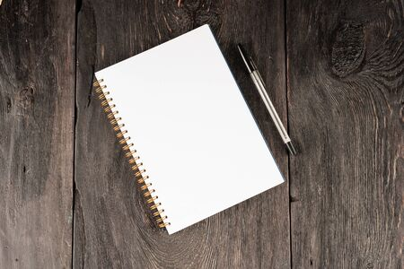 blank sheet in notebook for notes on a wooden table as a business concept. Reklamní fotografie