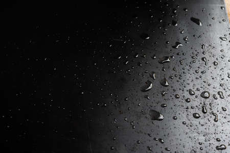 drops of water on a sheet of iron - Gray wet background texture 免版税图像