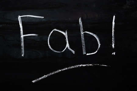 chalk lettering on a metal plate. word Fab - short for fabulous.