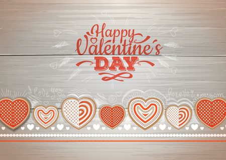 Top view of valentine cookies on a wooden background. Happy Valentine`s Day