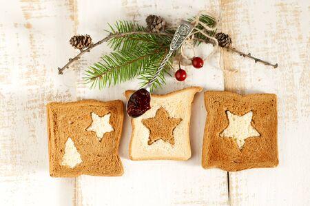 Christmas breakfast. Slice toast bread on wooden boards. photo
