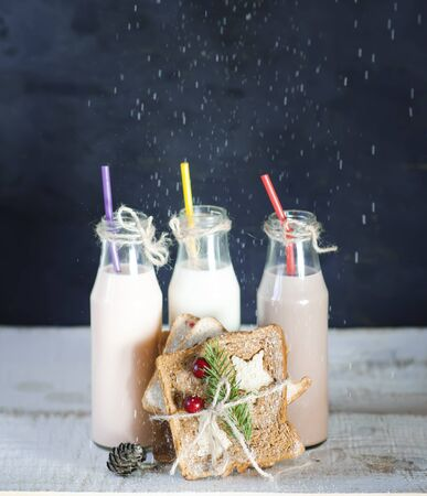 Three retro bottles with milk cocktail   and slice toast bread decorated for Christmas. photo
