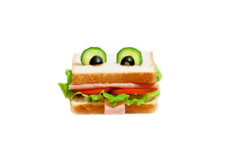 bocadillo: S�ndwich Rana divertida para un ni�o sobre un fondo blanco. Foto de archivo